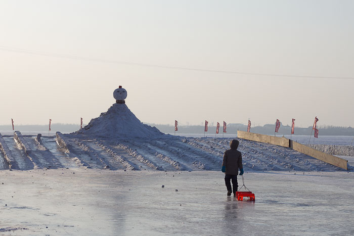 Tobogganing on small snow slides on the Songhua River, Harbin.