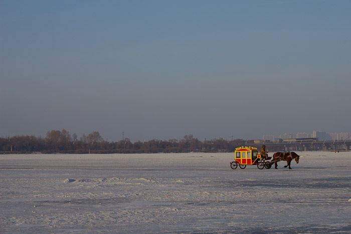 Horse and carriage ride on the frozen Songhua River, Harbin.