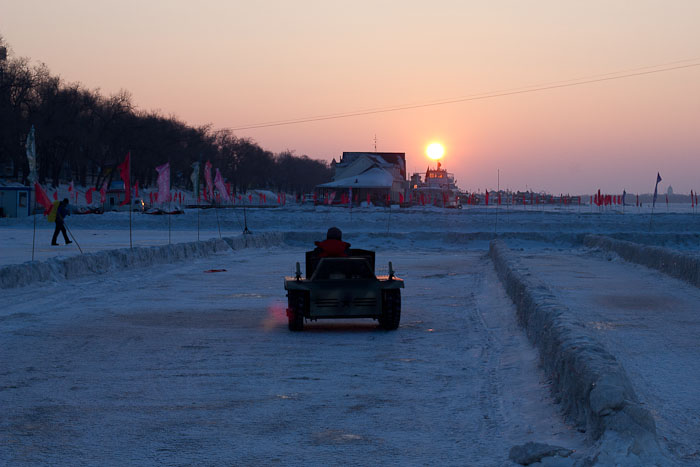Driving a tank on the frozen Songhua River, Harbin.